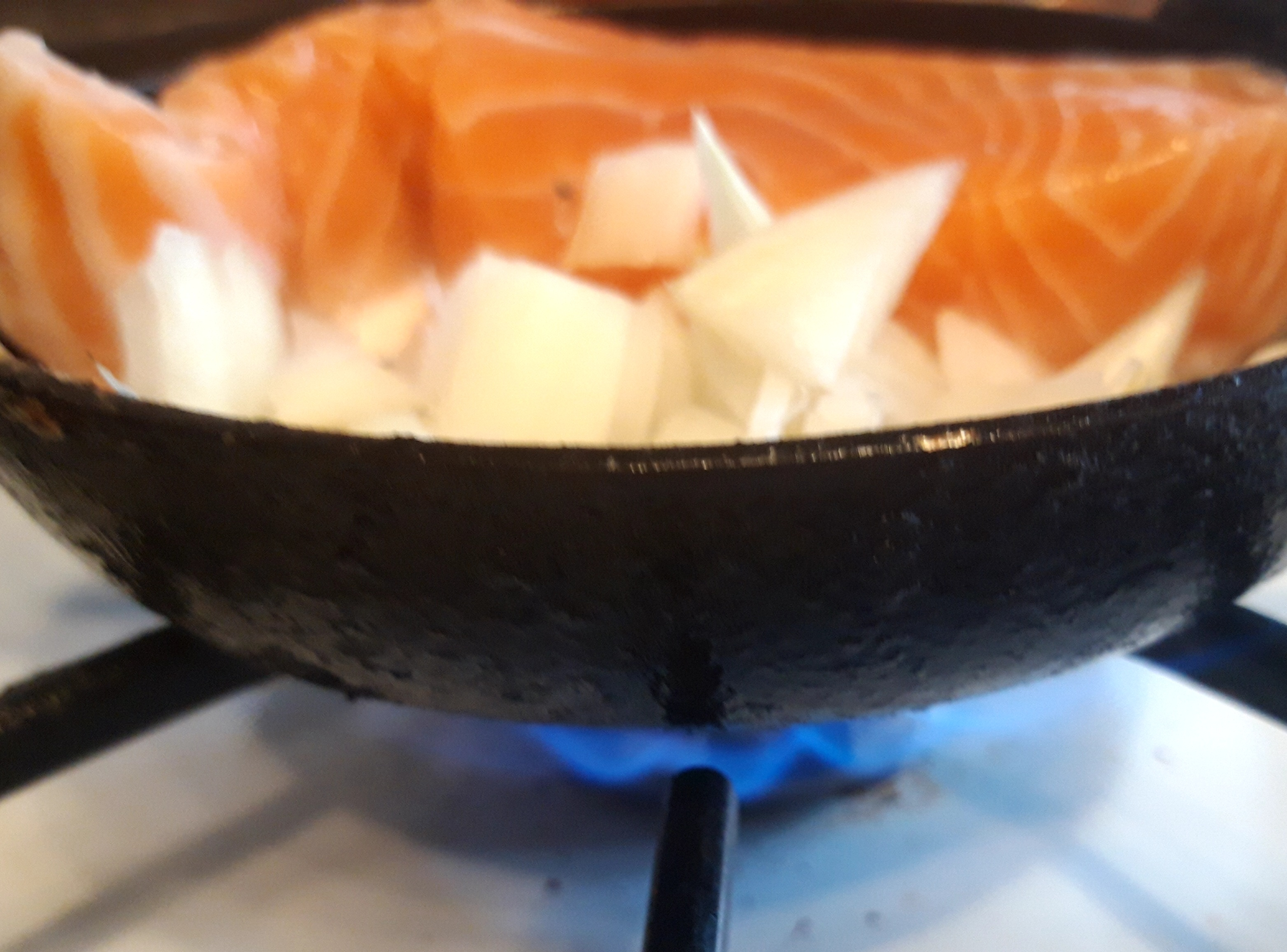 Frying onion with fresh salmon