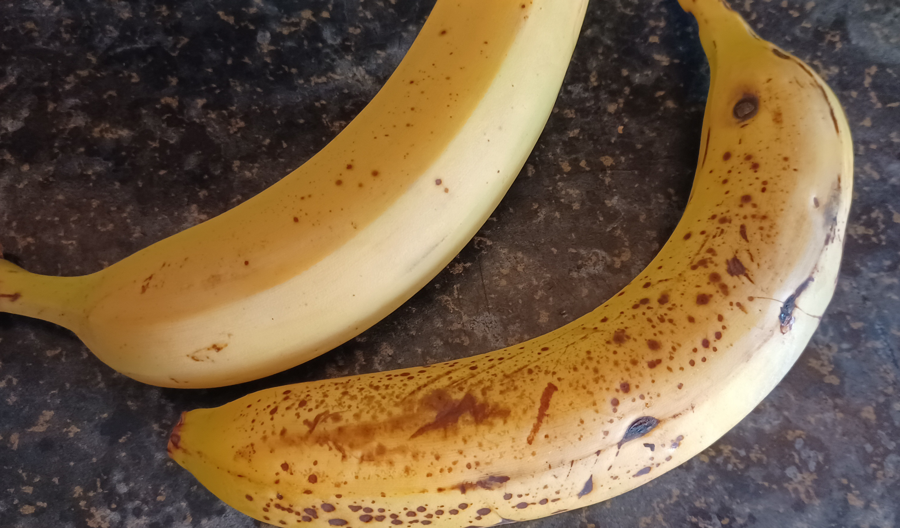 Either of these bananas is suitable for banana ice cream but the bottom one is more ripe and will therefore be more sweet